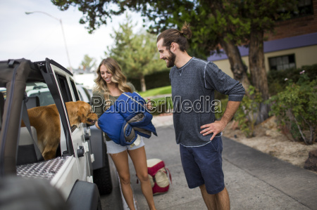 young couple and dog preparing to