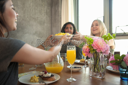 group of friends having meal at