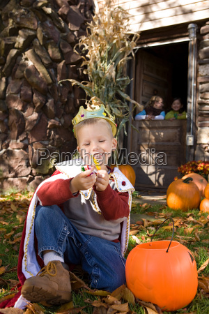boy in costume with sweets