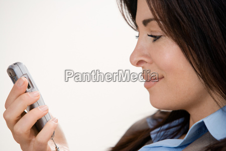 businesswoman, using, cell, phone - 18864960