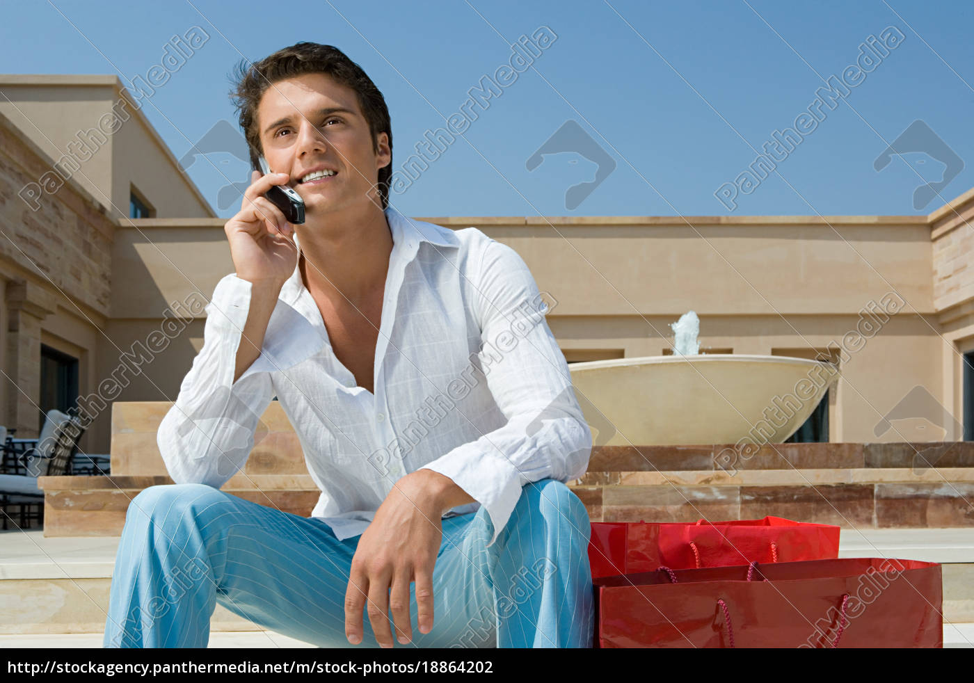 young, man, on, cellphone - 18864202