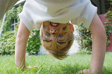 boy playing in garden
