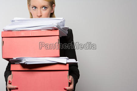 woman holding stack of paperwork