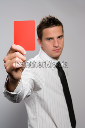 businessman holding a red card