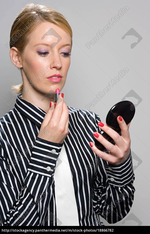 businesswoman, applying, lipstick - 18866782