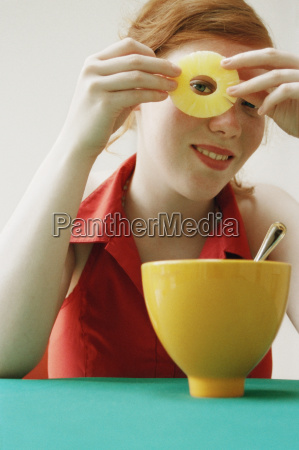 girl looking through hole in slice