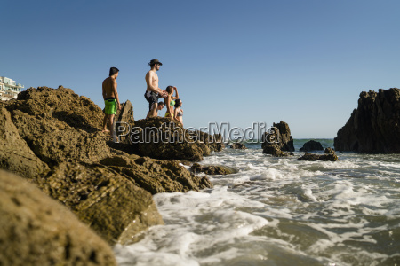 young adult friends exploring rocks on