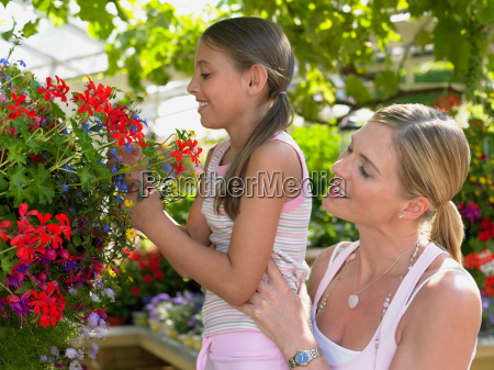 mother and daughter looking at flowers