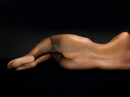 rear view of a woman lying