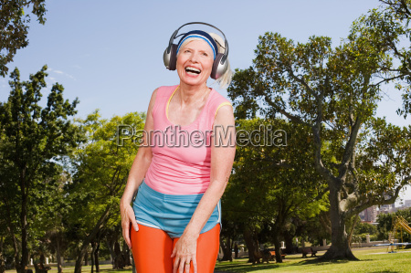 senior adult woman exercising in park