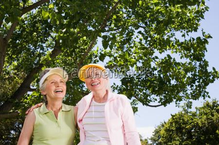 two senior adult women in park
