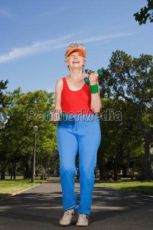 senior adult woman jogging in park