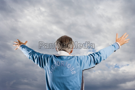 senior adult man with arms raised
