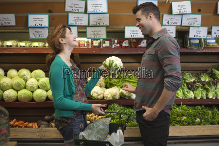 man and woman chatting whilst shopping