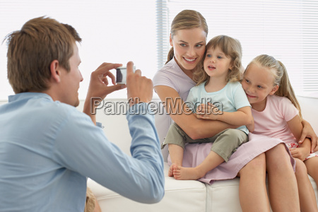 family posing for a photograph