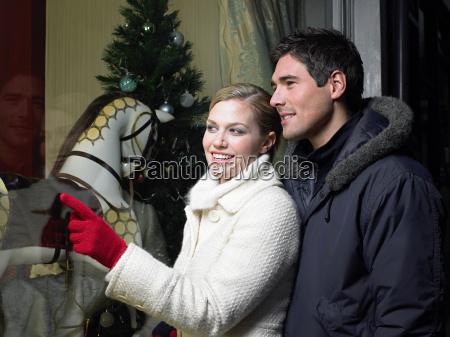 mid adult couple christmas shopping