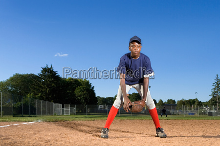teenage boy playing baseball