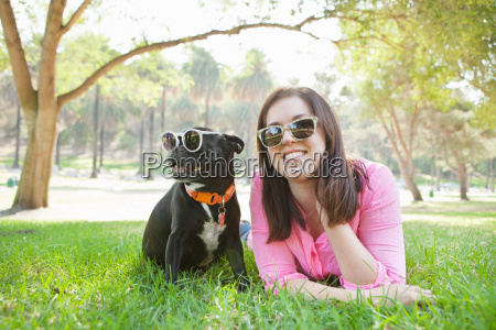 portrait of young woman and dog