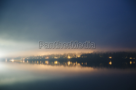 misty view of waterfront and lights