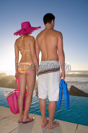 couple standing on the edge of