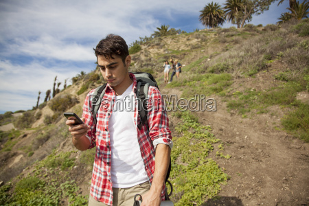 young man at bottom of hill