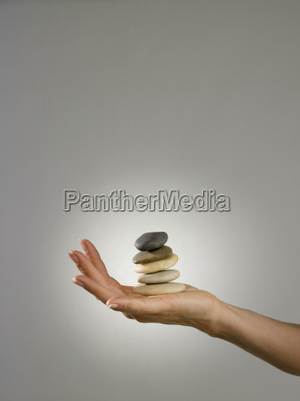 woman holding pile of stones