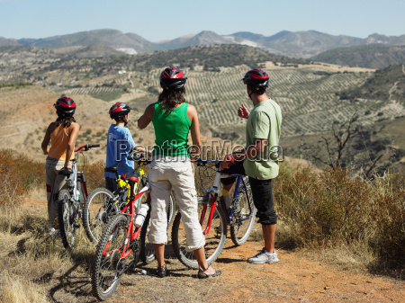 cyclist family looking at view