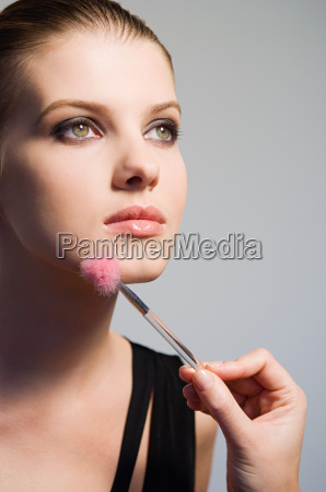 woman having make up applied