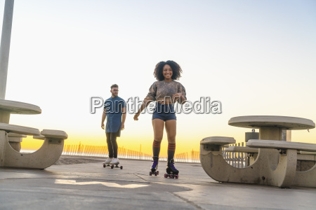 young man on skateboard following mid