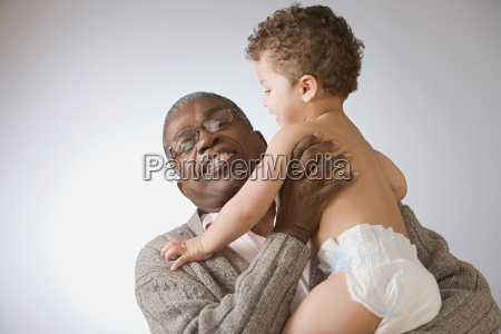 grandfather holding baby boy