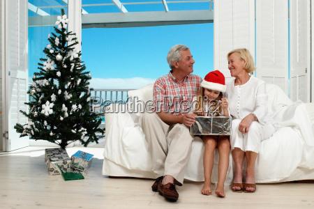girl opening her christmas present