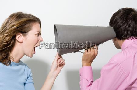 woman shouting down megaphone