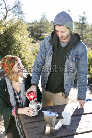 young couple in rural setting sitting