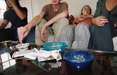 friends smoking in living room