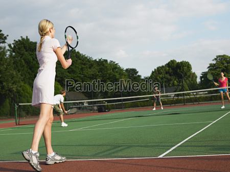 young people playing tennis