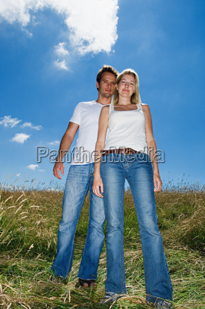 young couple standing in a field