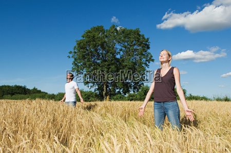 couple standing in a field