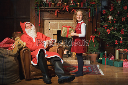 santa claus giving girl a gift