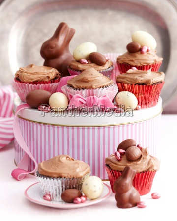 chocolate cupcakes covered with icing decorated