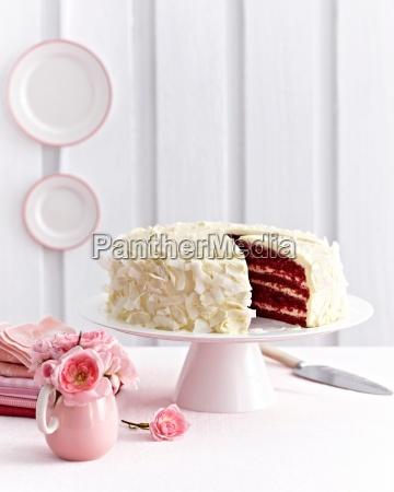 pink velvet chocolate layer cake covered