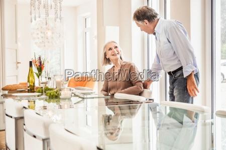 senior woman sitting at dinner table