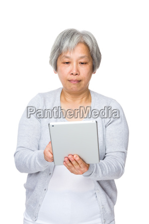 senior woman use of tablet pc