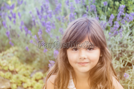 attractive little girl with lavenders in
