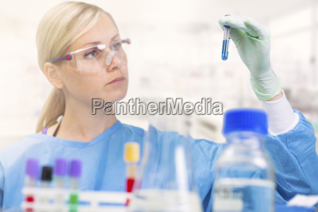 scientist working with analysis samples in