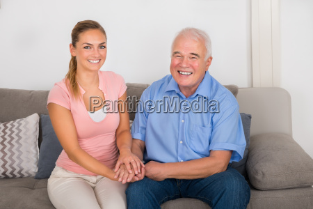 woman sitting on sofa holding her