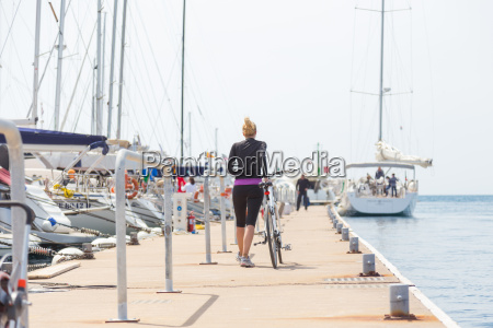 young active woman with cycling on