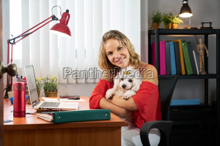 portrait business woman working with pet