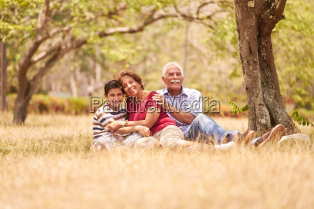 grandparents senior couple hugging young boy