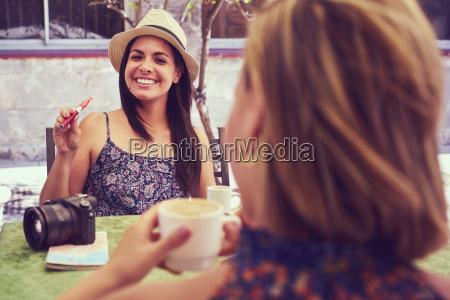 happy woman smoking electronic cigarette drinking