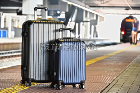two plastic travel suitcases on the